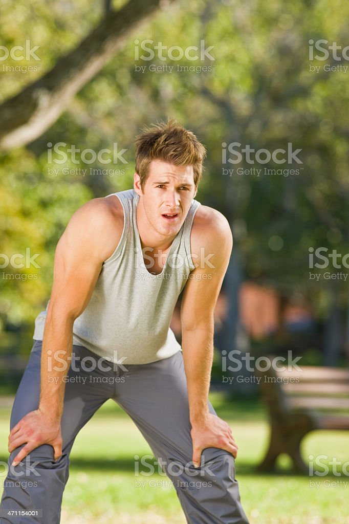 Young man leaning forward royalty-free stock photo