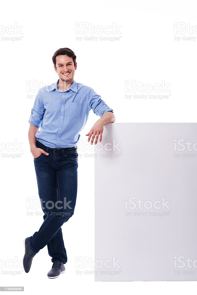 Young man leaning on the empty board stock photo