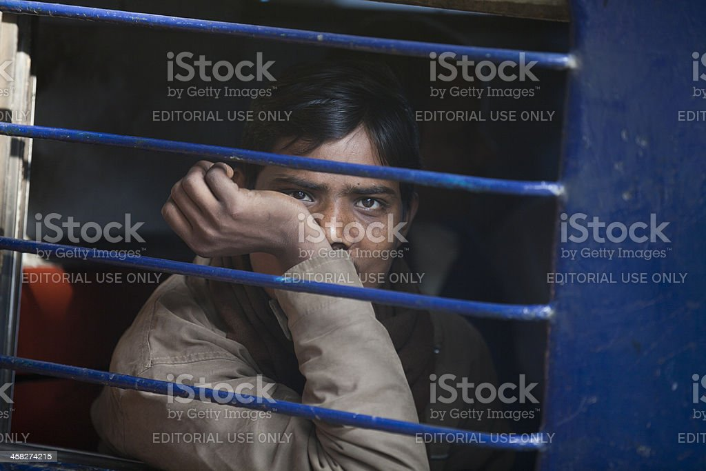 Young man leaving in a blue train royalty-free stock photo