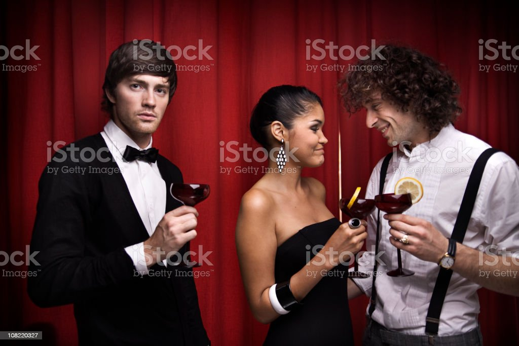 Young Man Left Out from Conversation at Cocktail Party stock photo