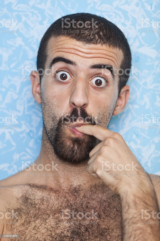 Young Man Licking Finger royalty-free stock photo