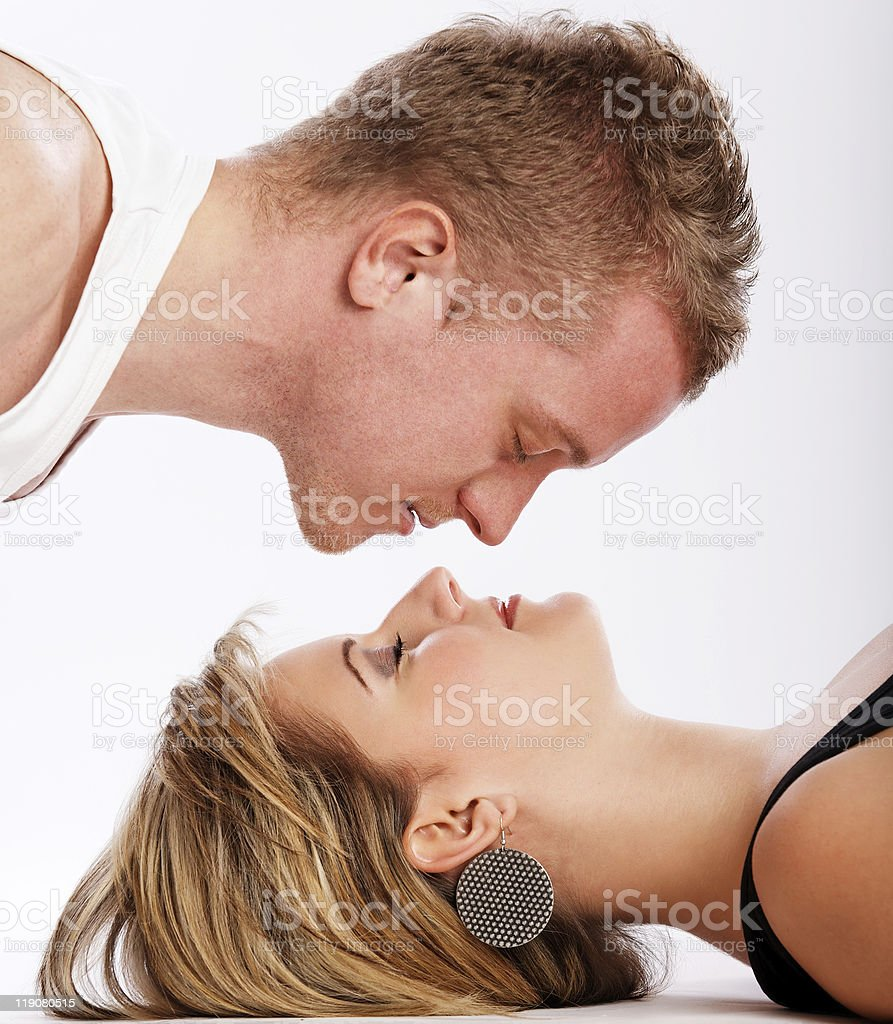 Young man lies over his girlfriend royalty-free stock photo