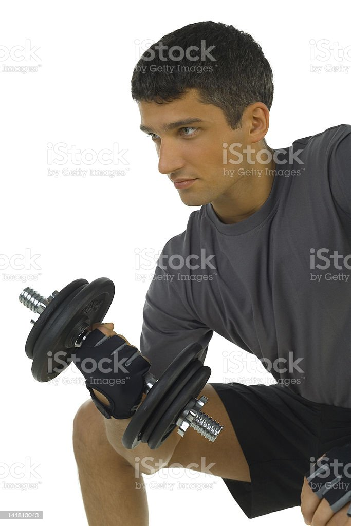 Young man lifting dumbbell royalty-free stock photo
