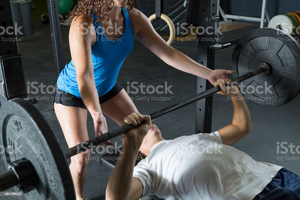 Young Man Lifting Weights stock photo