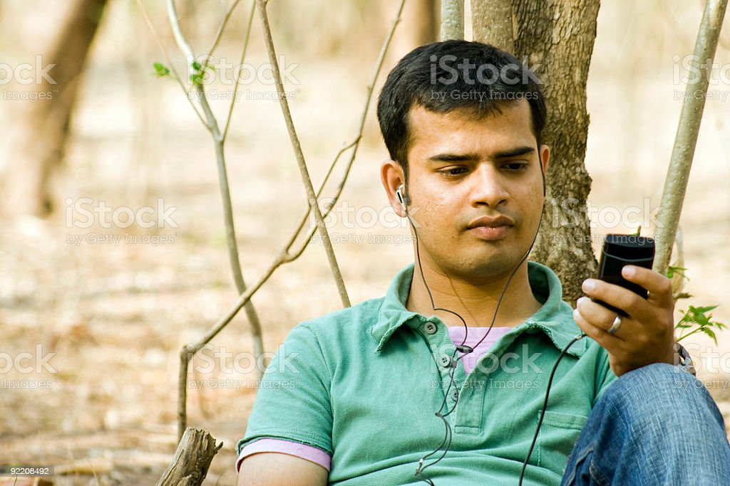 Young man listening music. royalty-free stock photo