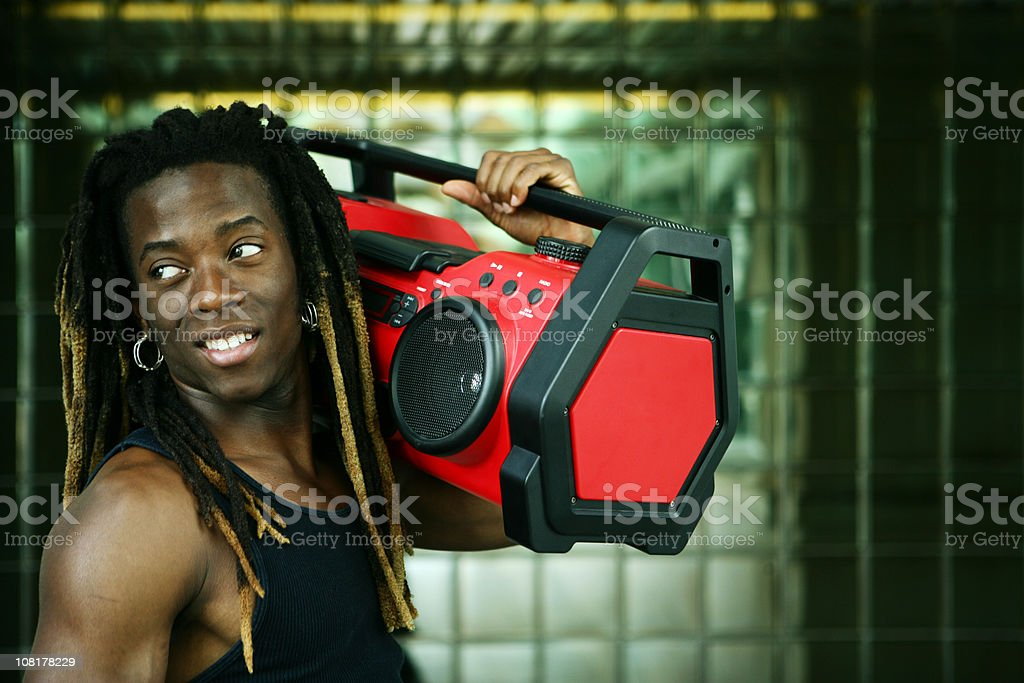 Young man listening to music on Boom Box royalty-free stock photo