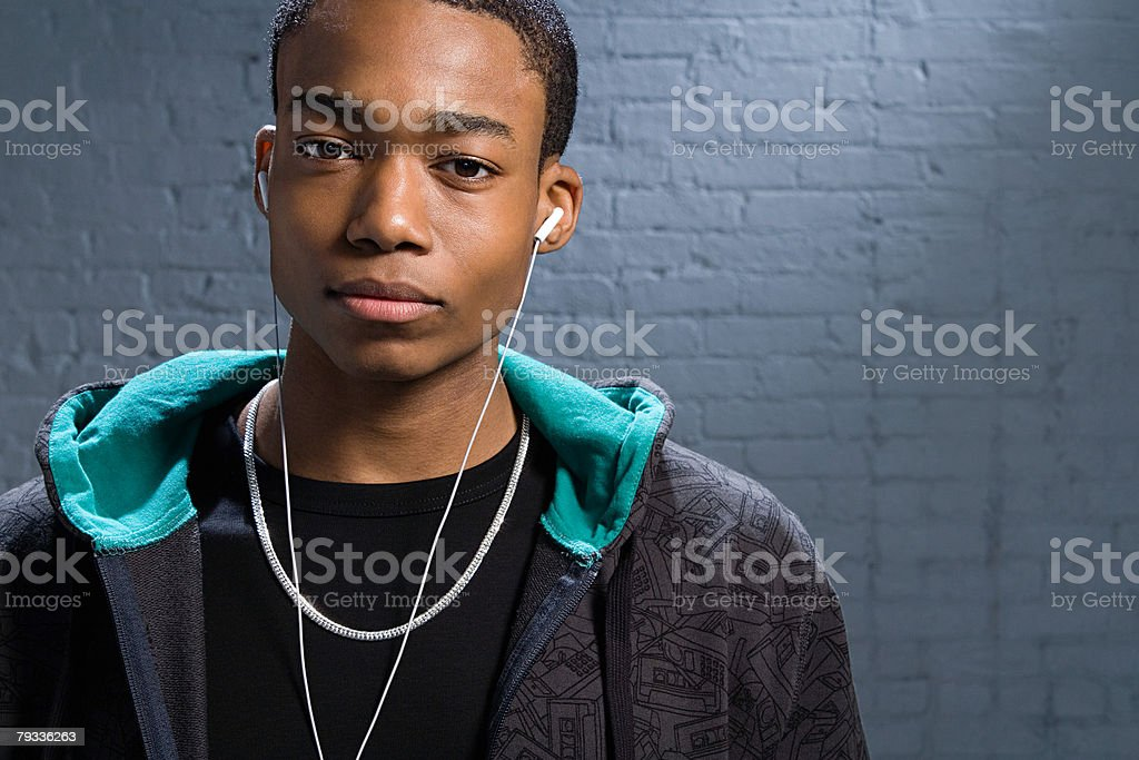 Young man listening to music royalty-free stock photo