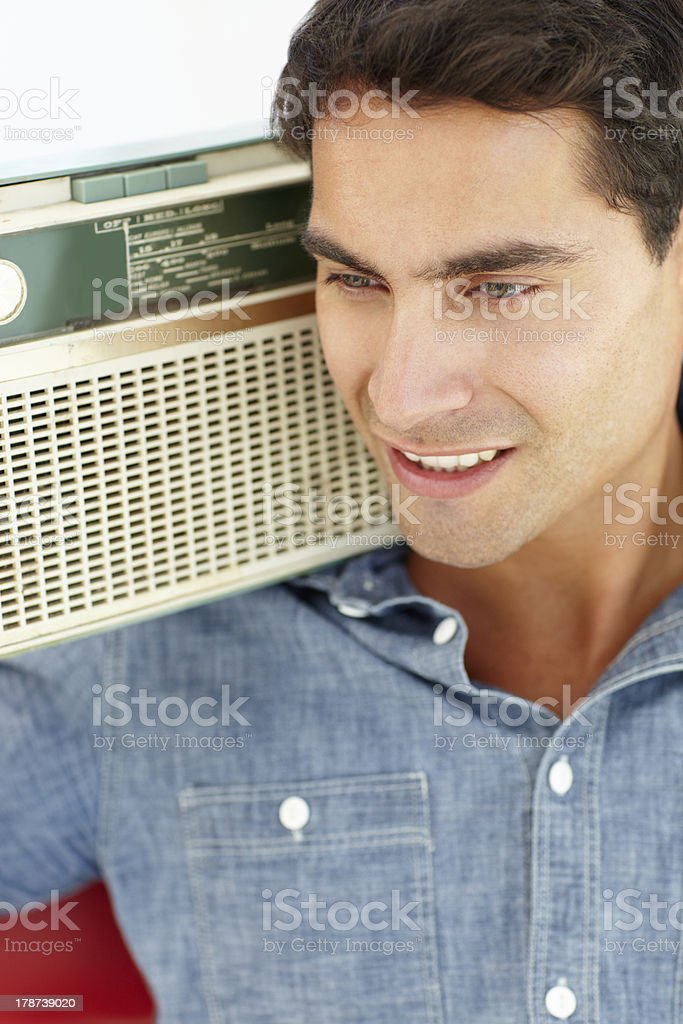 Young man listening to radio relaxing in chair