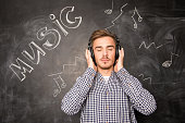 young man listens to music in headphones