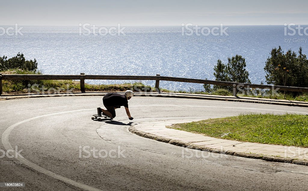 Young man longboarding royalty-free stock photo
