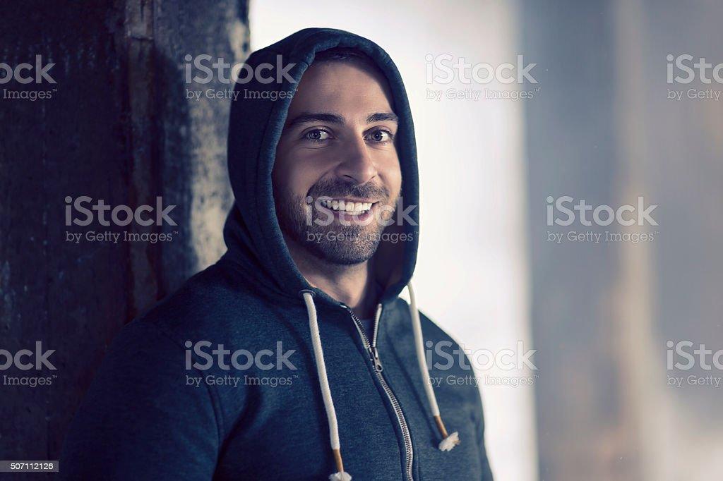 Young man looking at camera stock photo