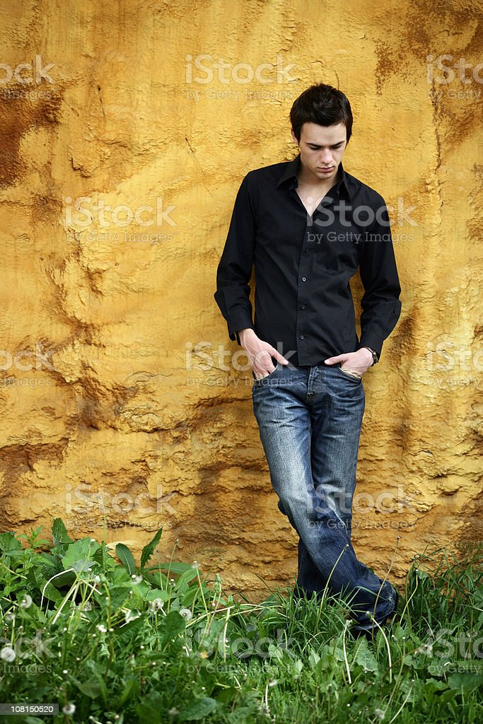 Young Man Looking at Feet royalty-free stock photo