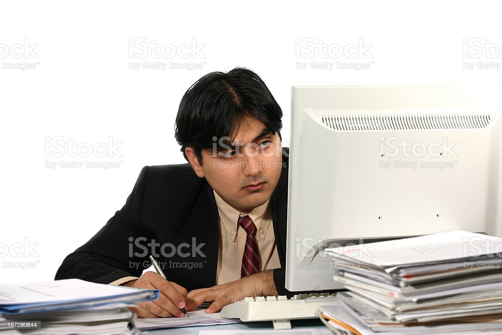 Young man looking at monitor in office, working royalty-free stock photo
