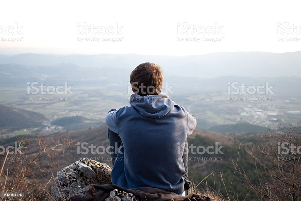 Young man looking at the view, copyspace stock photo