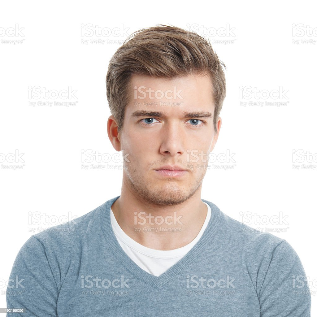 young man looking displeased stock photo