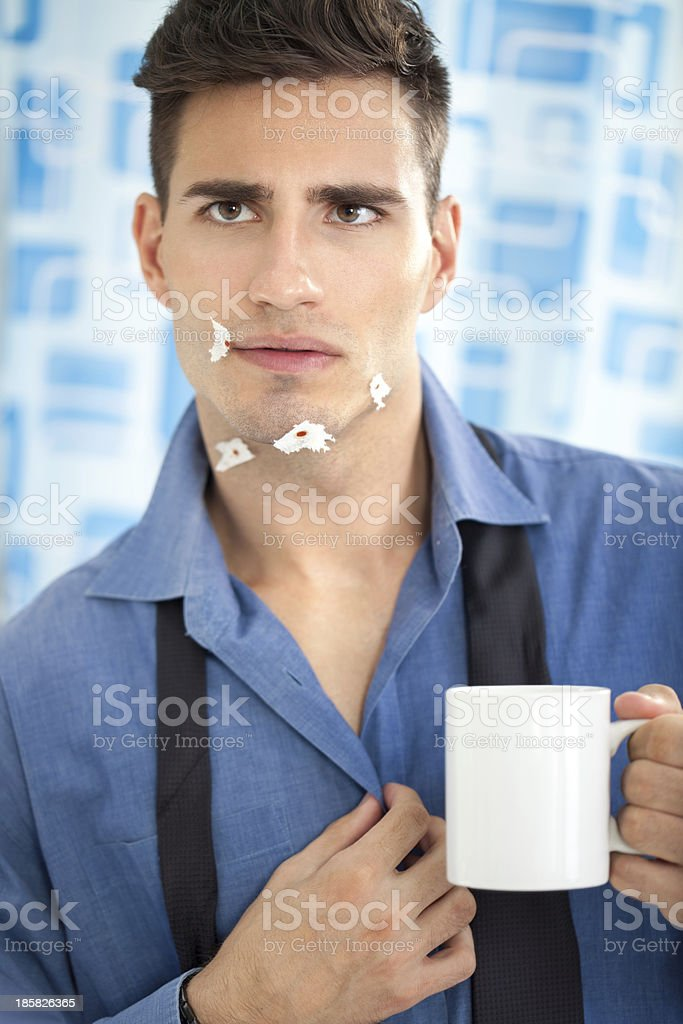 Young man looking his injury face in mirror royalty-free stock photo