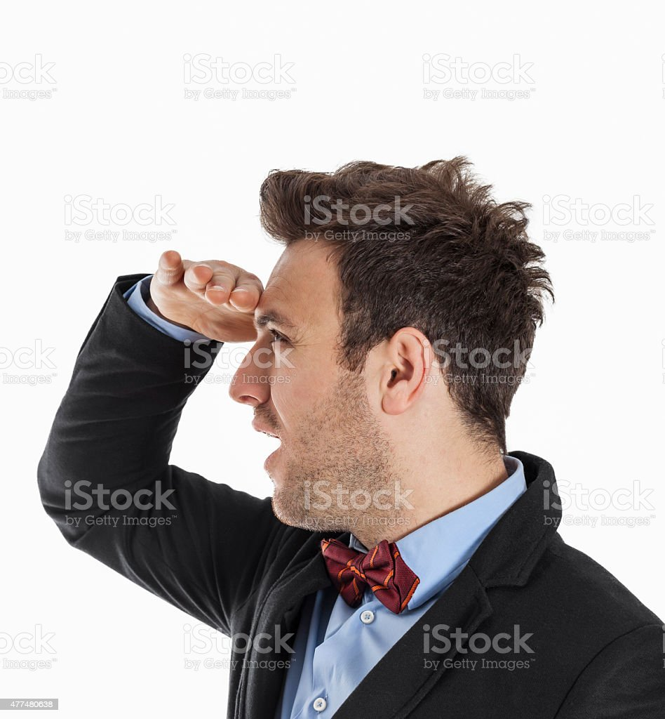 Young Man Looking in the Distance with Wonder stock photo