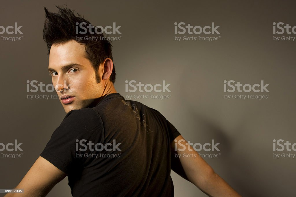 Young Man Looking Over Shoulder Staring At Camera stock photo