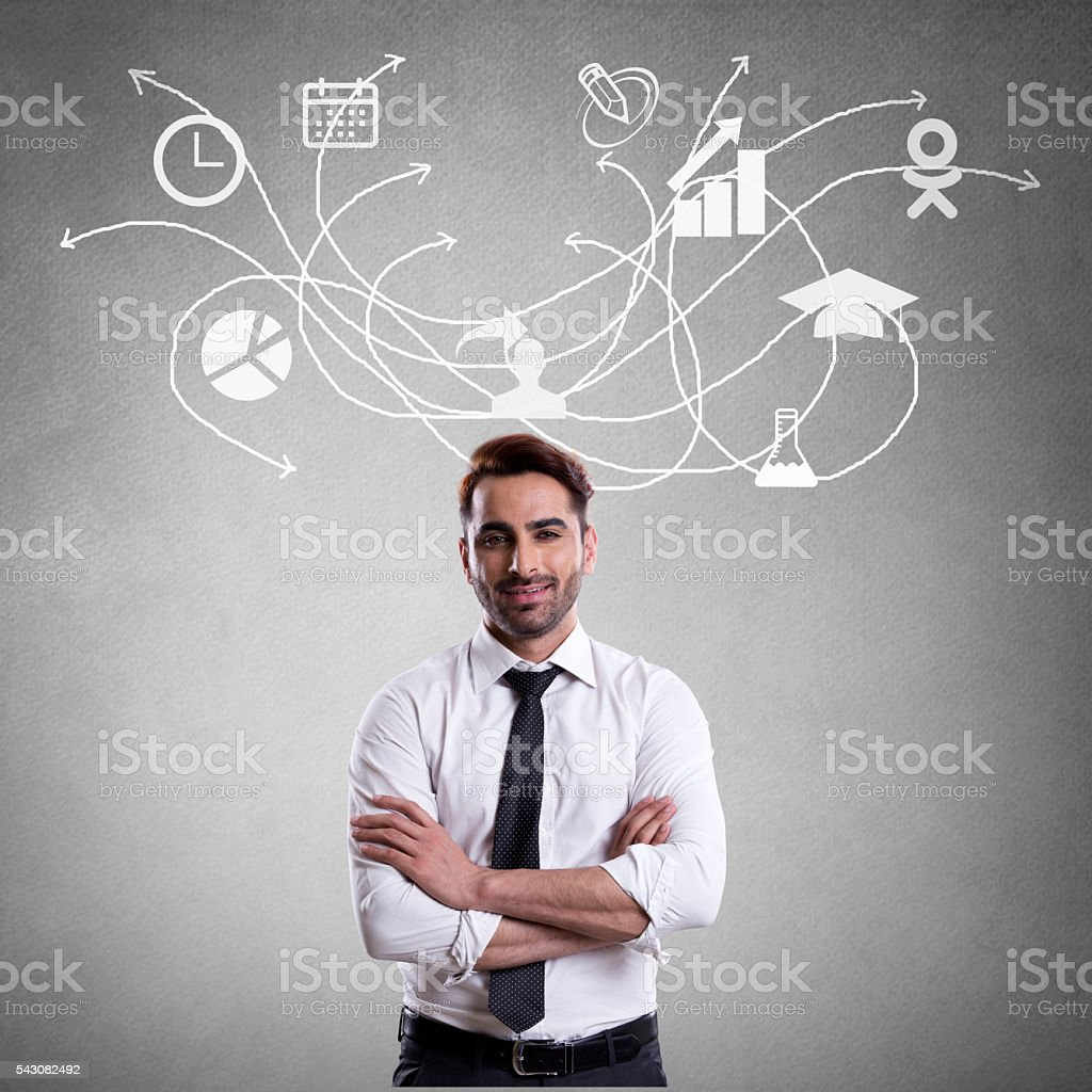 Young man looking progress report stock photo
