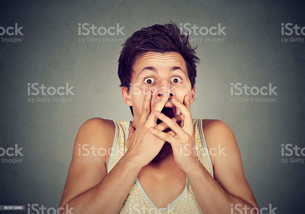 young man looking shocked scared stock photo