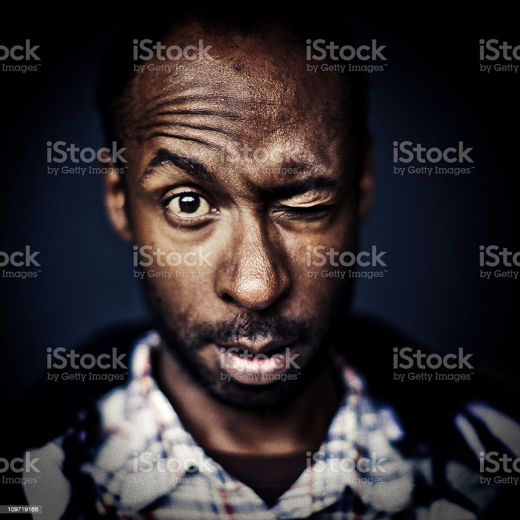 young man looking surprised stock photo