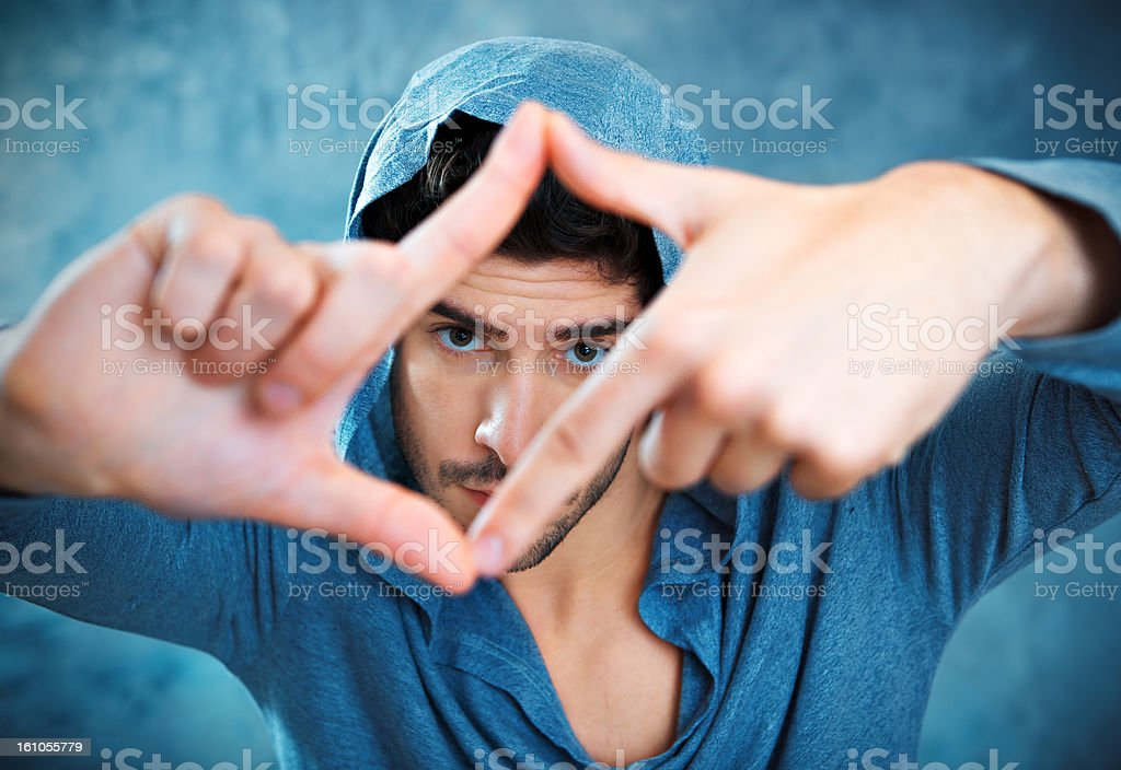 Young Man Looking Through a Finger Frame royalty-free stock photo