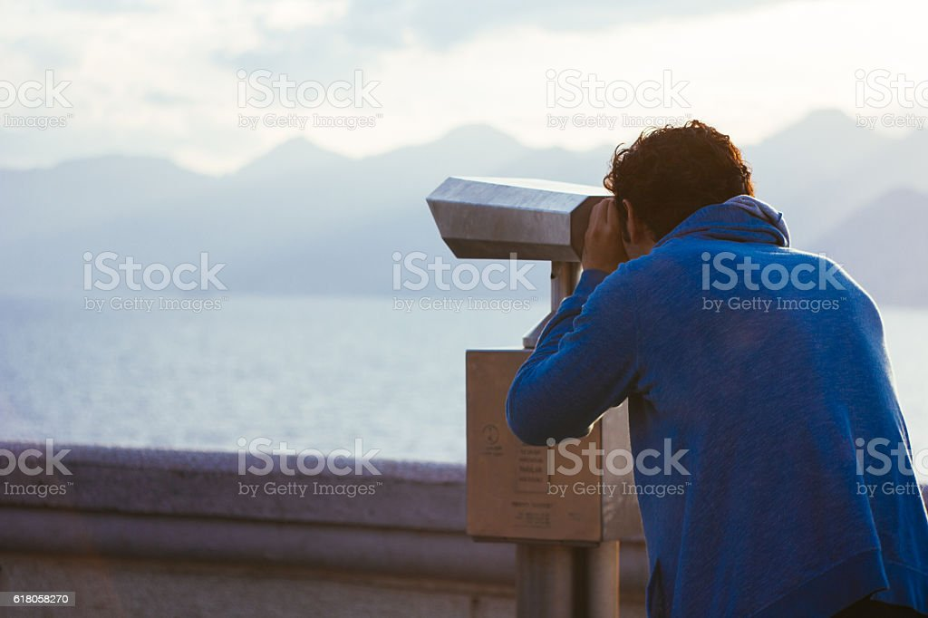 Young man looking through future stock photo