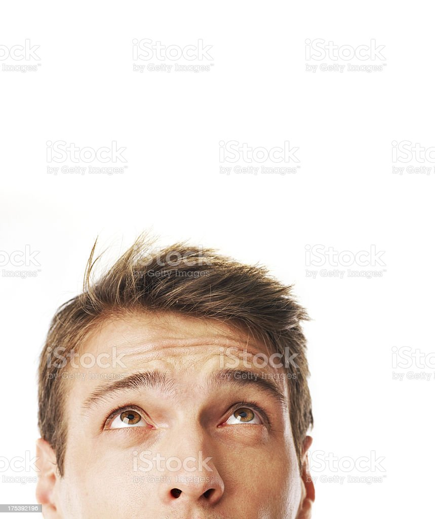 young man looking up stock photo
