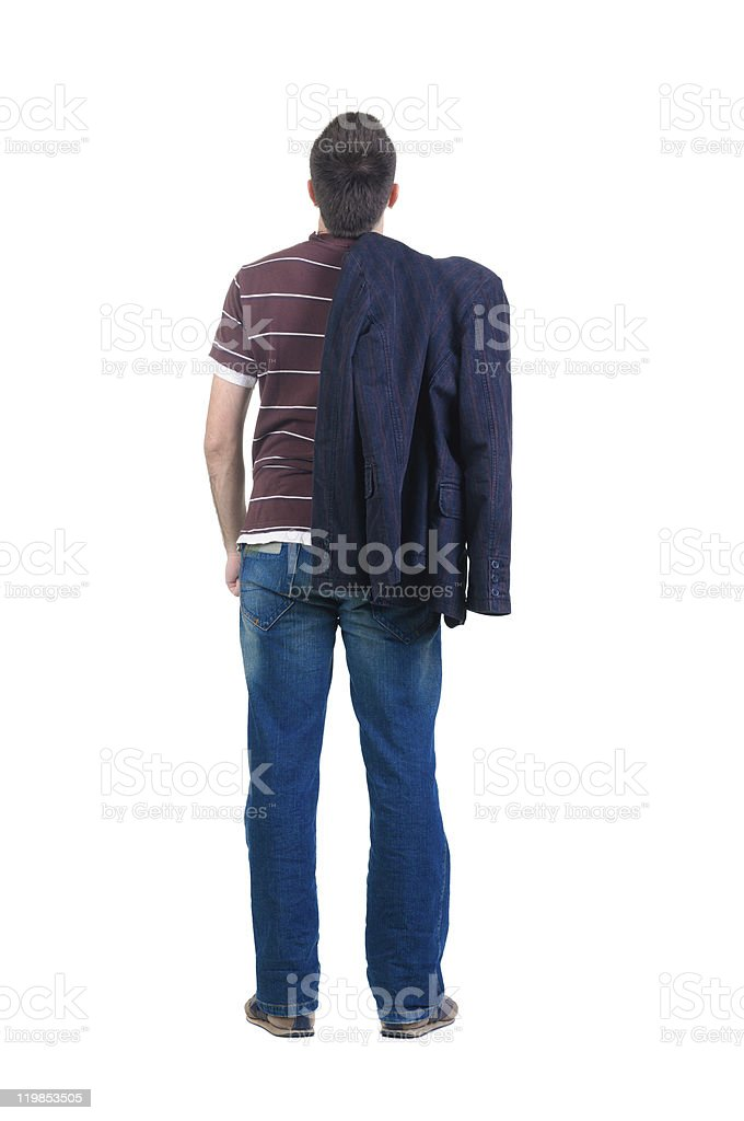 young man looks ahead. rear view. stock photo