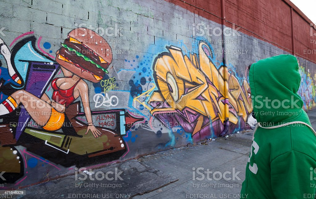 Young man looks graffiti stock photo