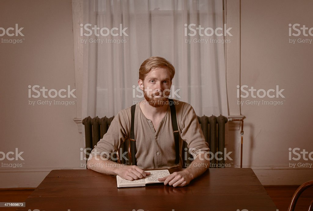 Young Man Looks Up From Book, Vintage royalty-free stock photo