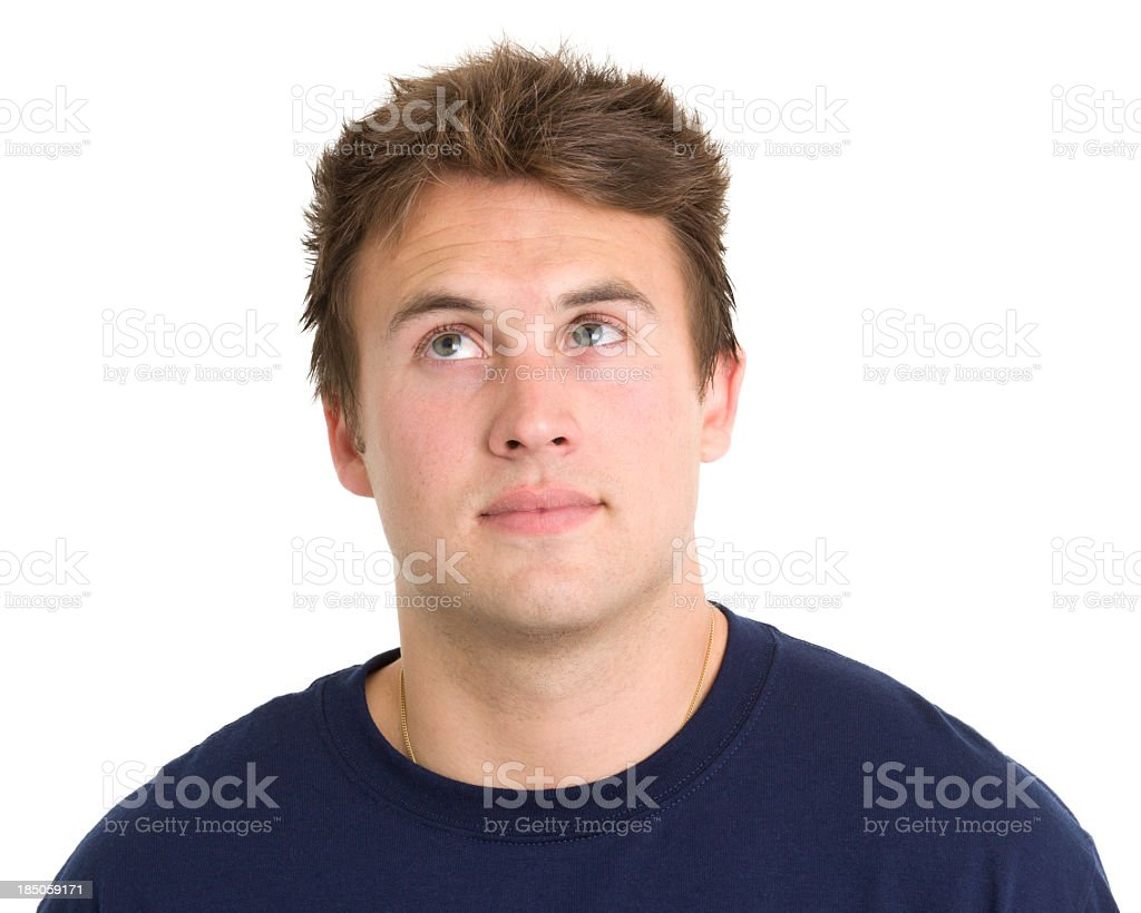 Young Man Looks Up in Thought royalty-free stock photo
