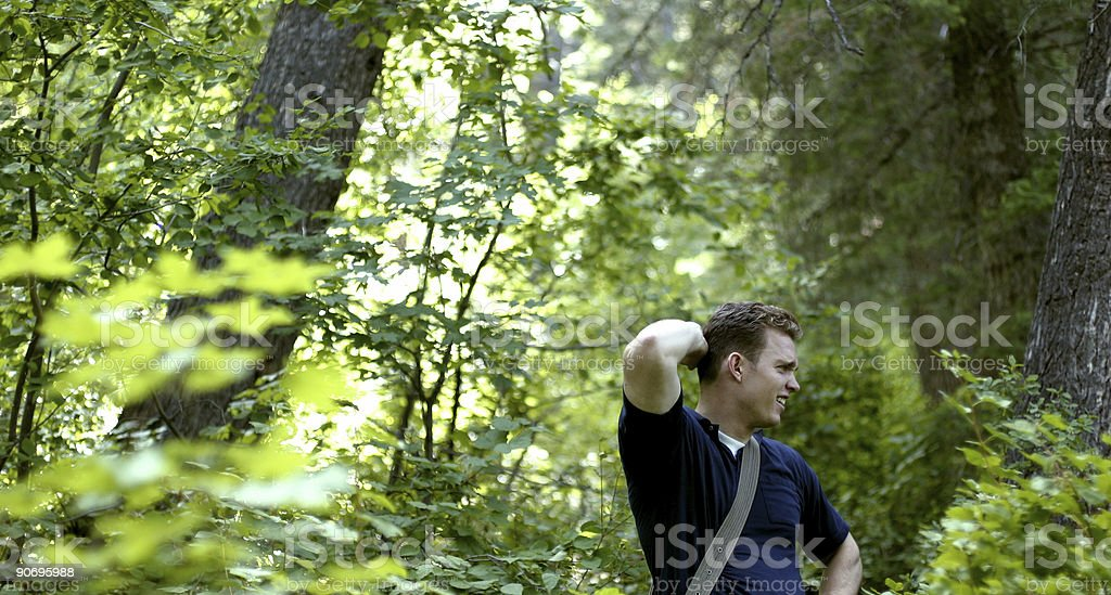 Young man lost in a forest royalty-free stock photo