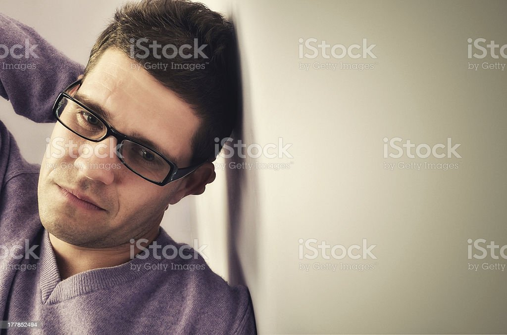 Young man lost in thought royalty-free stock photo