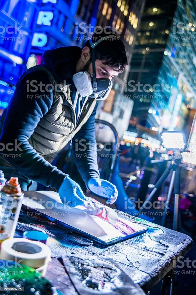 Young man make aerography painting for public at Time Square stock photo