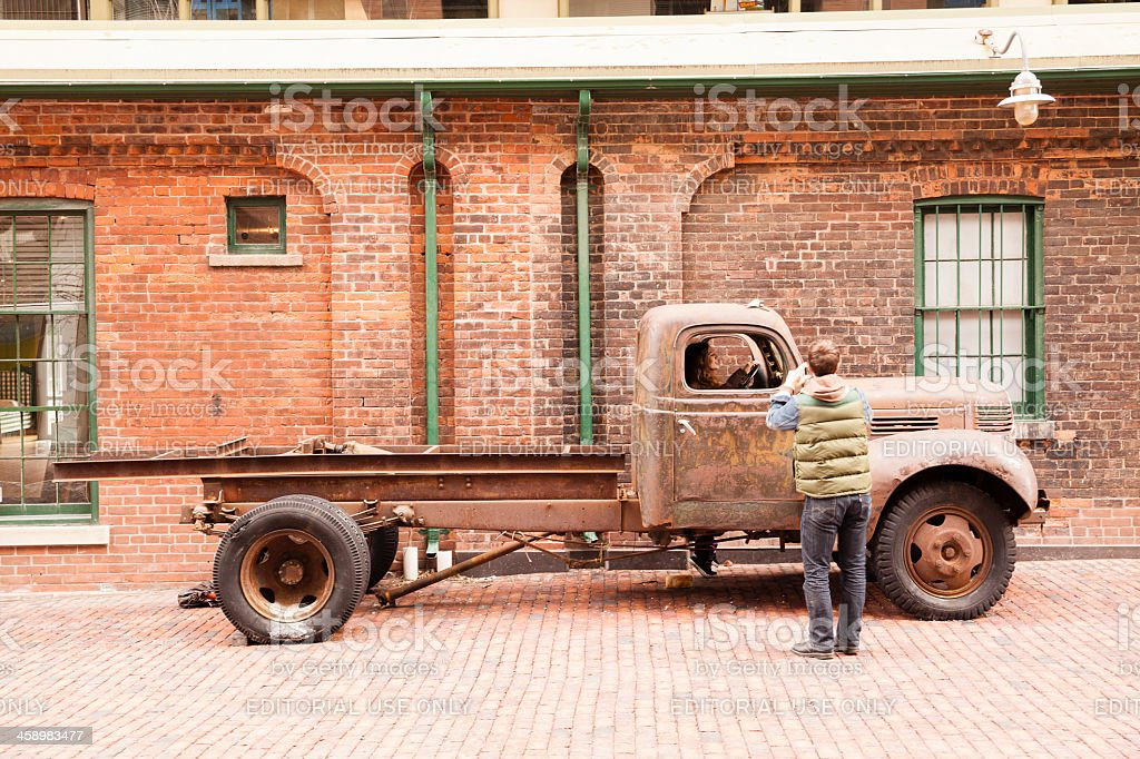 Young man make photo of girl, Distillery District, Toronto stock photo