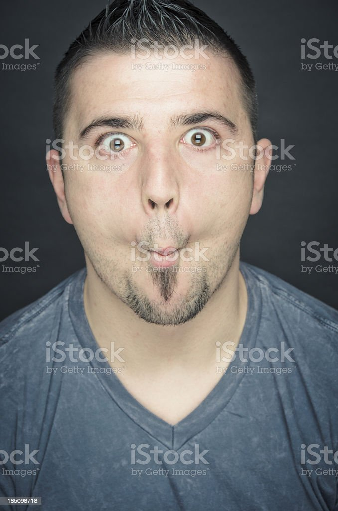Young Man Making A Face Fish Lips stock photo