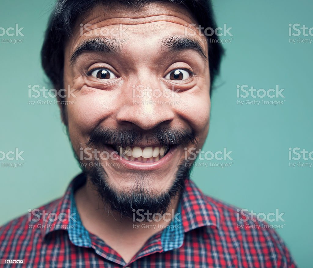 Young man making a funny face. stock photo