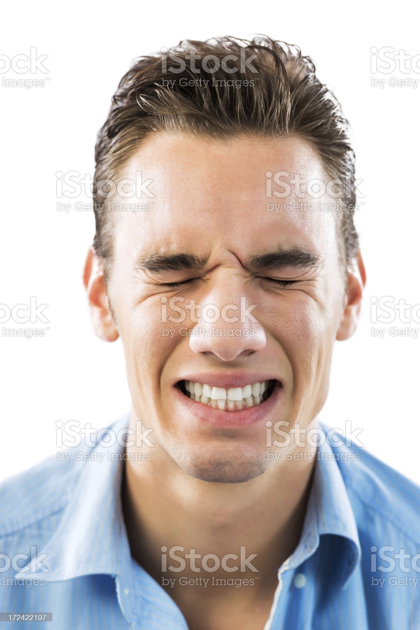 Young man making a grimace. royalty-free stock photo