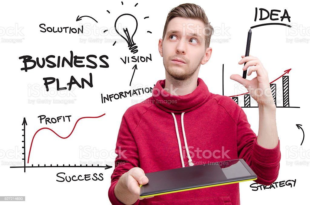 Young man making business plan stock photo