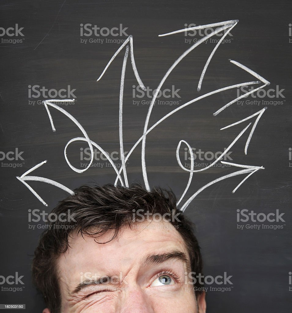 Young man making choices and decisions stock photo