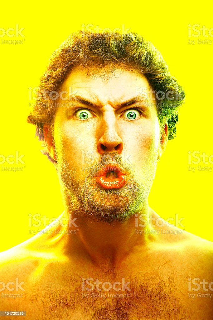 Young Man Making Crazy Face on Yellow Background royalty-free stock photo