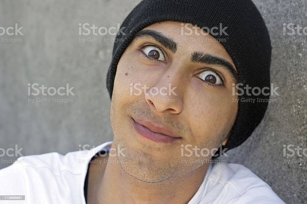 Young man making funny eyes royalty-free stock photo