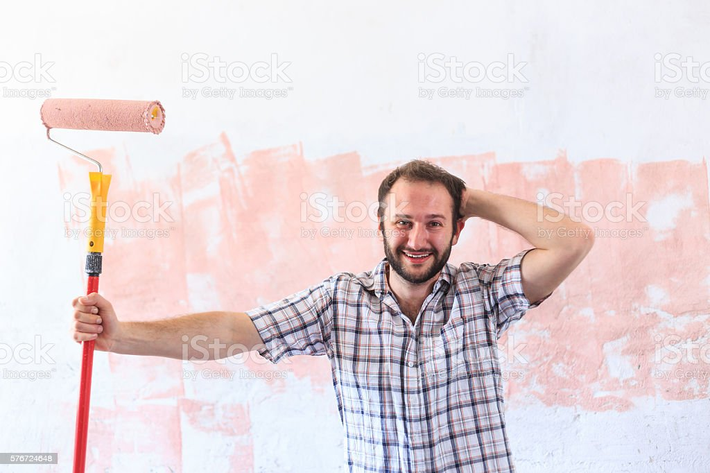Young man making home redecoration alone stock photo