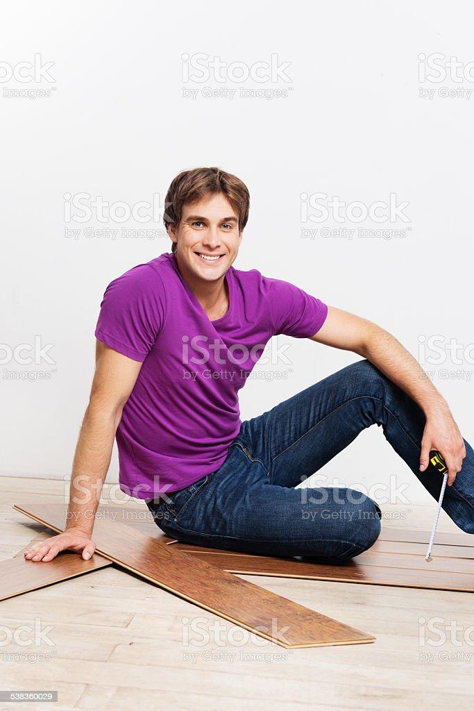 Young man measuring woodblock stock photo