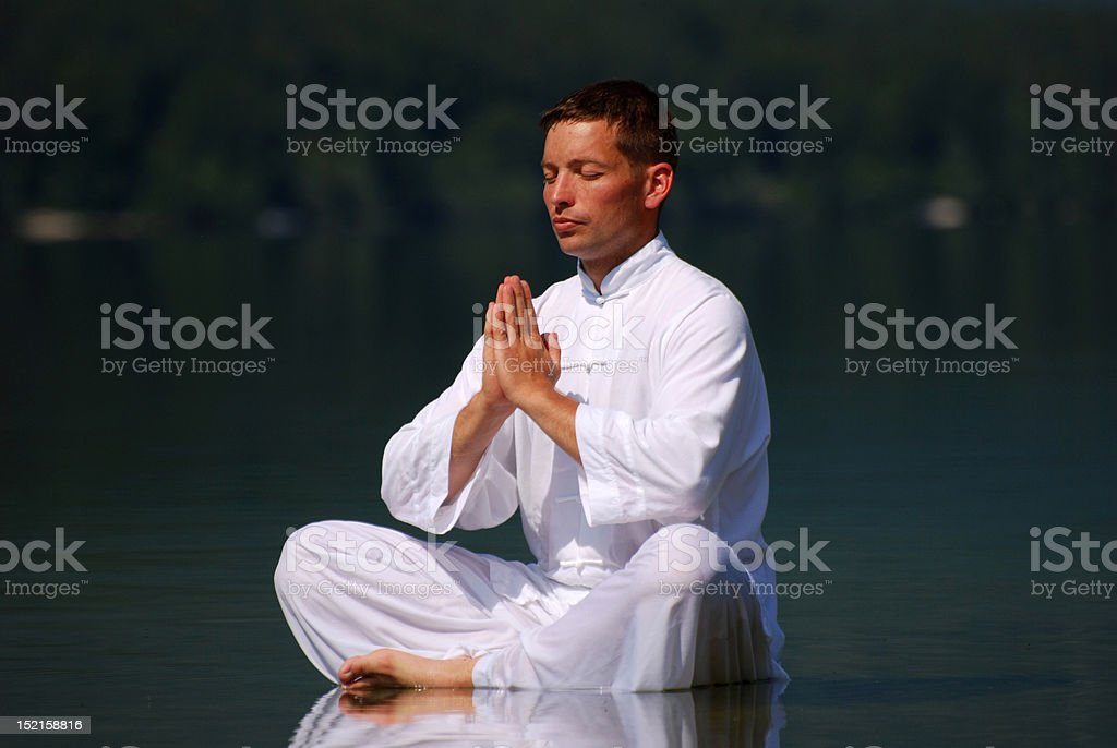 Young man meditating royalty-free stock photo