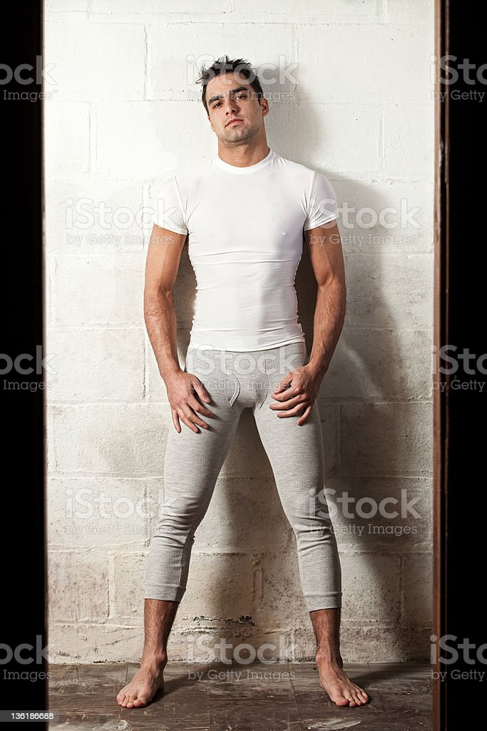 A young man modeling a t-shirt and long underwear stock photo