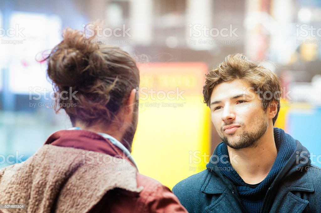 Young man not buying his friend's story stock photo