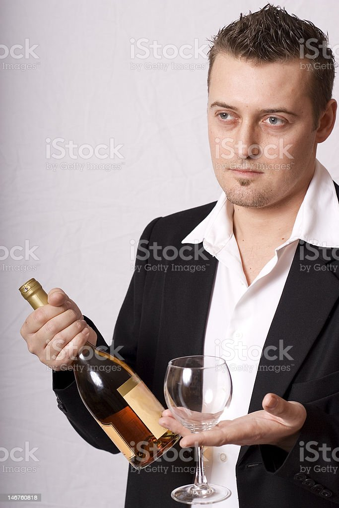 Young man offer wine royalty-free stock photo