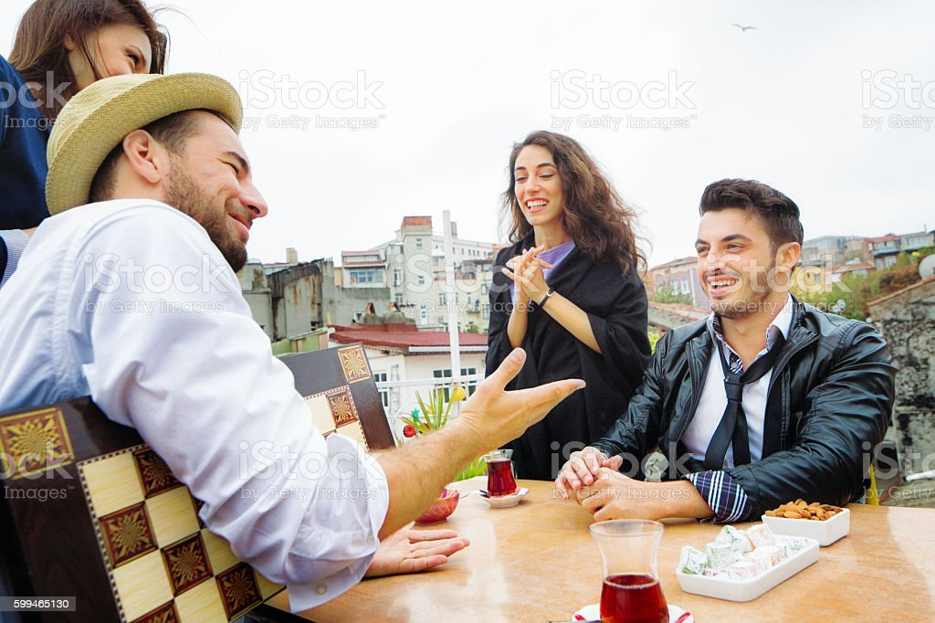 Young man offering friend to play tavla backgammon stock photo